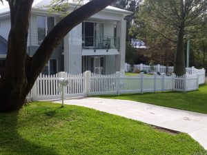 Modern House with PVC white picket fence